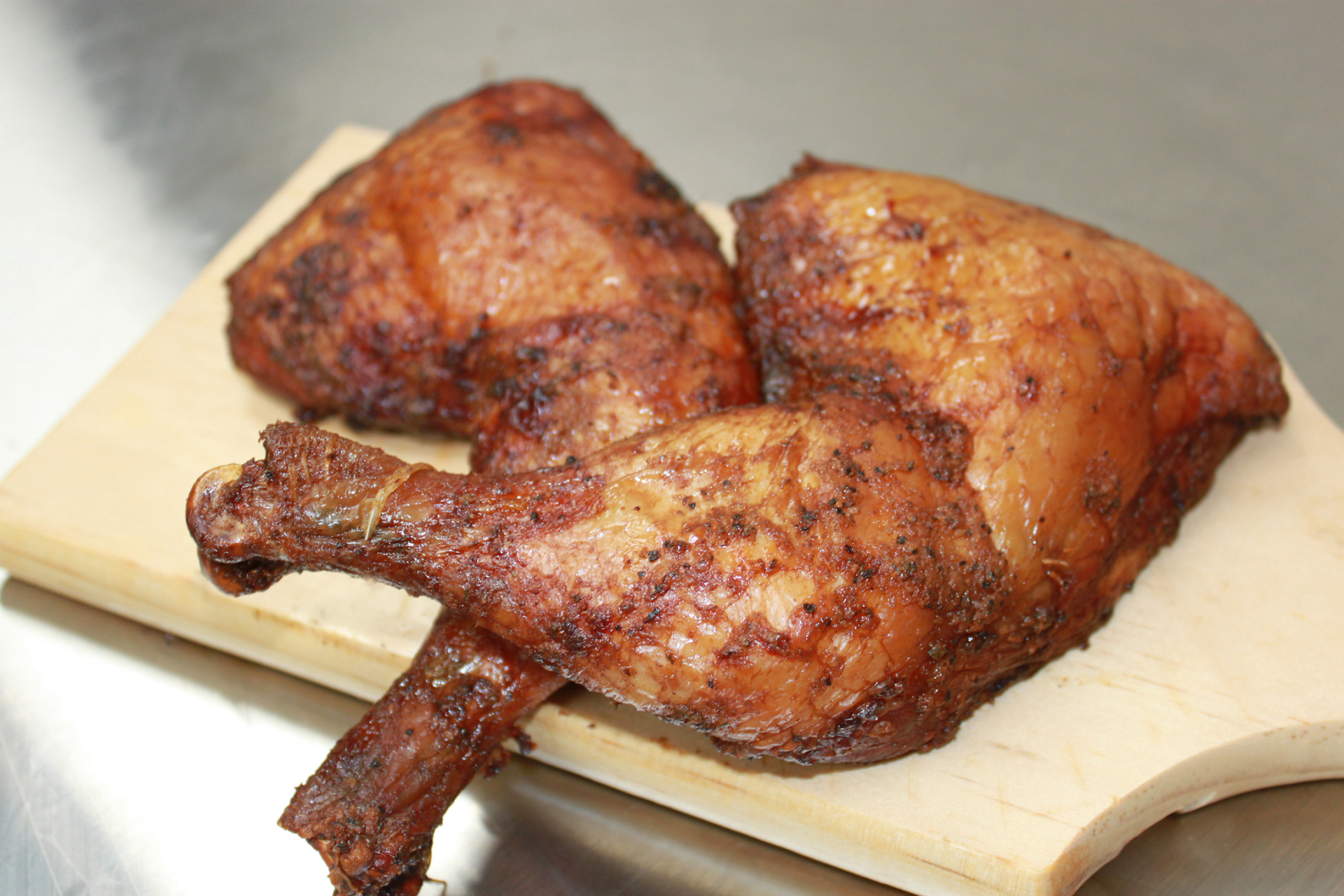 Smoked Chicken - Smoked, juicy flavor served on the bone.
