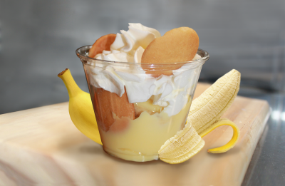 Banana Pudding with layers of sweet vanilla flavored custard, cookies & topped with whipped cream.