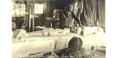William Shelton Carving a Totem Pole