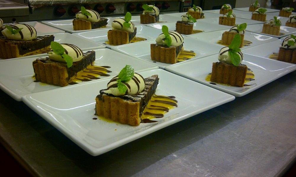 Rich Chocolate Tart with Vanilla Cream and Mango Puree
