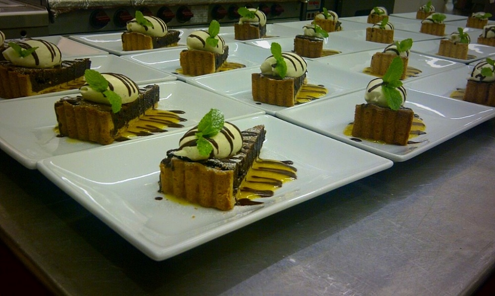 Rich Chocolate Tart with Vanilla Cream and Mango Puree