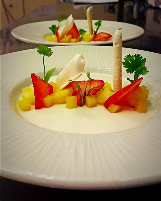 Coconut Panna Cotta, Diced Mango and Pineapple, Strawberries, Meringue, Micro Coriander