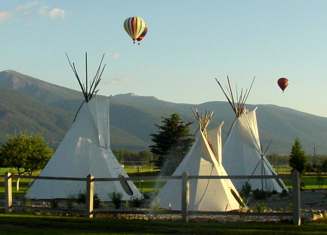 Replica of Salish encampment and hot air balloons