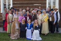 A group of volunteers in costume who helped out at Founders Day at St. Mary's Mission