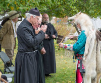 Salish elder performing a smudge ceremony at Founders Day
