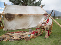 Mountain Man displaying antique weapons and firearms