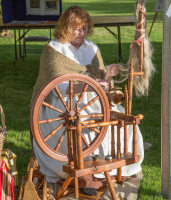 Woman spinning flax