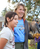 Kate Davis, Executive Director of Raptors of the Rockies with a peregrine falcon