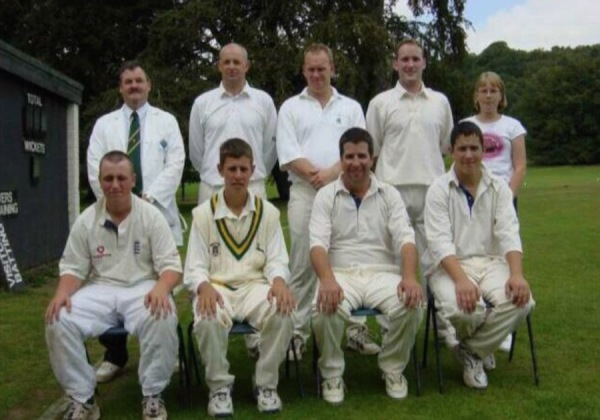 2003 2nd XI - Back Row: Mim Davies (Umpire and also current Chairman), Andy Hubbard, Fraser Ball, Jarrod Bell, Lindsey Wright (Scorer) - Front Row: Callum Jayes, Matthew Wright, Peter Wright, Ian Wright.