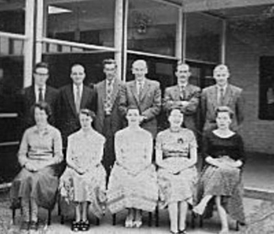 Colonel Frank Seely School original teachers 1957 - Back Row: Mr.Donnelly, Mr. Cook, Mr. Rowlinson, Mr. Dixon (headmaster), Mr. Dawson and Mr. Poole Front Row: Miss Bryan, Mrs. Waddington, Miss Coxon (later Mrs Young), Mrs Canon, Mrs.Whitehead (school Secretary).