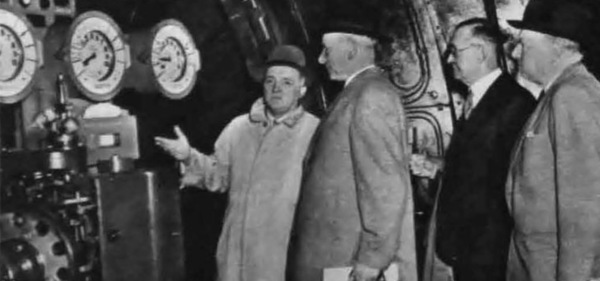 Area general manager A. Hill shows Calverton winding-engine house to Lord Leathers. Behind stands N.C.B. chairman Sir Hubert Houldsworth.