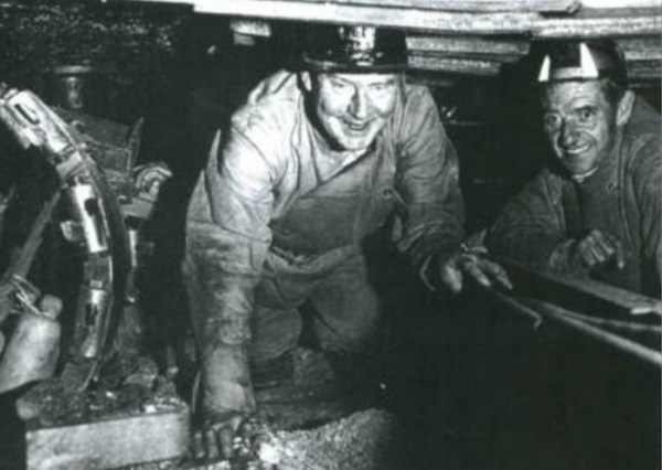 June : Leader of the Labour party, Hugh Gaitskell visited the colliery. He crawled 30 yards down a 3ft 6inch seam to see a machine cutting coal. With him here is N. R. Smith the area general manager.
