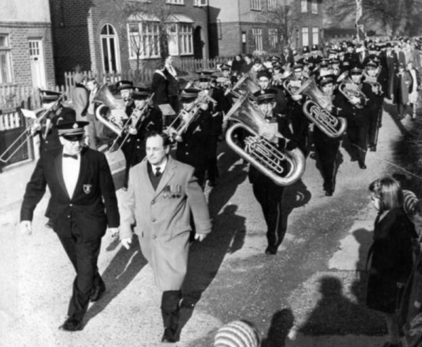 1963 band marching. David Nabarro leading the way.