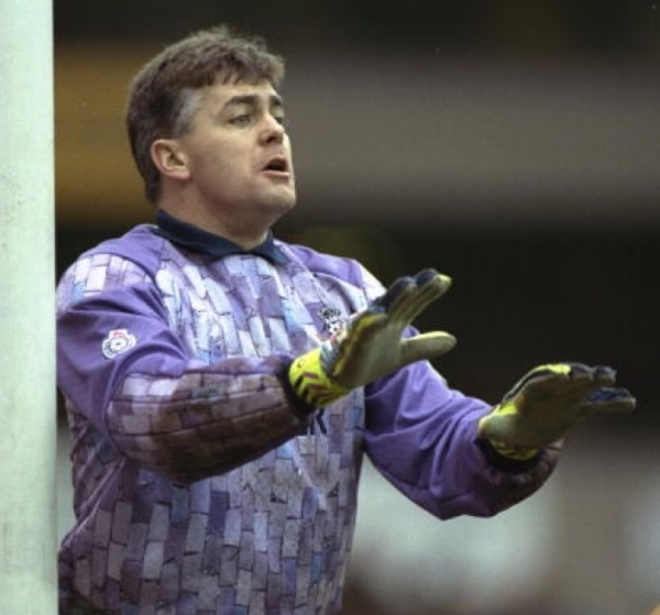 March, 1991: Six foot, two inch Notts County goalie, Steve Cherry, calms down his back four during the FA Cup Sixth Round match against Spurs.