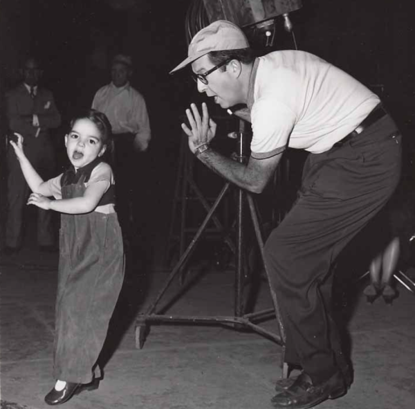 Young Liza appears on the set