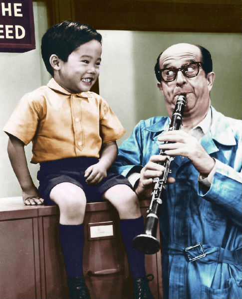 A tinted scene from 75 and a Half Trombones. Phil with young Jon Ogawa