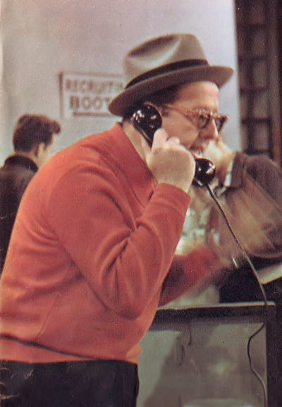The star takes a call at rehearsal.  He likes to use telephones --- there are three of them in his apartment