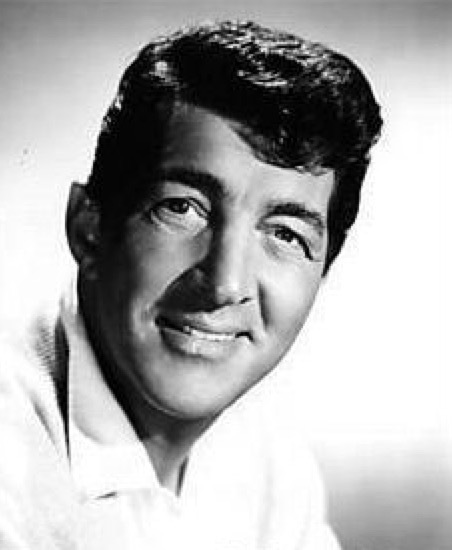 "Dean Martin - American singer, film actor and comedian. Dean's hit singles included ""Memories Are Made of This"", ""That's Amore"", ""Everybody Loves Somebody"", ""Mambo Italiano"", ""Sway"", ""Volare"" and ""Ain't That A Kick In The Head?"". One of the leaders of the Rat Pack, he was a major star in four areas of show business: concert stage/night clubs, recordings, motion pictures, and television."