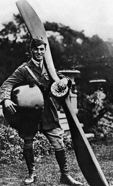 In the rear garden of his home with the propeller and famed red spinner from one of his Nieuport Scouts of 60 Squadron.