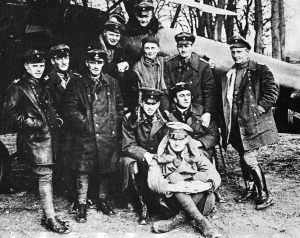 Jagdstaffel pilots from left to right: Karl Allmenroder, Hans Hinsch, Sebastian Fester, Karl Schafer, Manfred von Richtofen (in cockpit), Kurt Wolff (below Manfred), Georg Simon, Otto Brauneck. Seated left to right: Leutn. Esser, Lothar von Richtofen, Konstantin Krefft