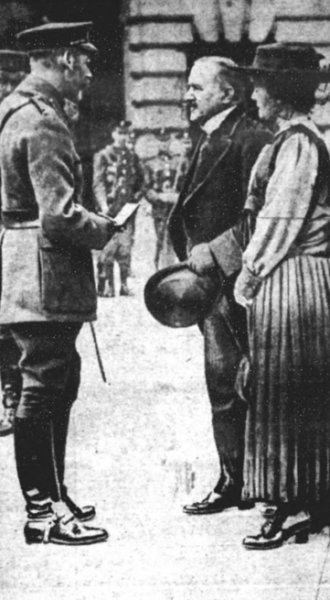 Left, 22 July 1917: Father and mother receiving his posthumous VC from King George V.