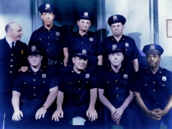 Some of the cast of the 53rd Precinct - Standing, left to right: Captain Block (Paul Reed), Muldoon (Fred Gwynne), Schnauser (Al Lewis), Rodriguez (Jack Healy). Seated, left to right: Nicholson (Hank Garrett), Toody (Joe E. Ross), O'Hara (Al Henderson) and Julie (Mel Stewart).