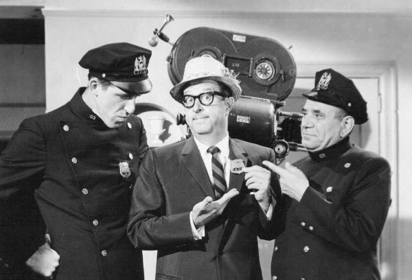 Phil Silvers pops in.