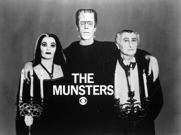 Yvonne De Carlo (as Lily Munster), Fred Gwynne (as Herman Munster) and Al Lewis (as Sam Dracula).