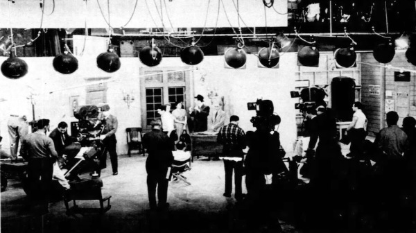 Behind the scenes. Three cameras and a Hollywood-size stage are needed for the show. Phil (with hat) and cast run through the show. Looks like Harry Gresham and Margaret Hamilton (Bilko Enters Politics)