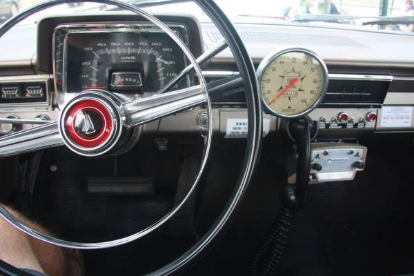 "It was a specially calibrated analog speedometer that was used to catch speeders in the 1960s before the use of radar. They would keep pace with a speeding car and glance at their ""Police Special "" speedometer and know the speed the offending car was going. Because it was officially certified, it was allowed in a court of law as proof. The regular dashboard speedometer the car came from the factory with was not as accurate."