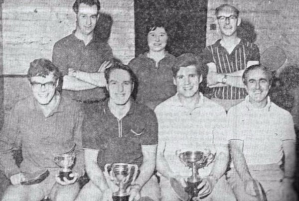 1970s Calverton Institute Table Tennis team with trophies won in that season.  Back row, P. Wallace, N. Kinton and B. Barton. Front row, J. Fordham, R. Kinton, B. Clarke and D. Harwood.