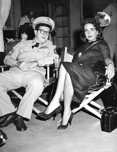 1957: Hollywood icon, Elizabeth Taylor, pops in to watch her husband, Mike Todd, on the 'Bilko' show!
