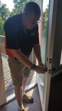 Pictured is Managing Locksmith, Ray Wentz, rekeying a house lock