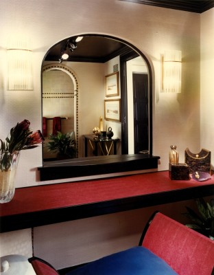 Photo of a luxurious bathroom and make-up area with custom furniture and lighting design all done by interior designer Steven C. Adamko, owner and founder of Spectrum Interiors based in Kalamazoo Michigan