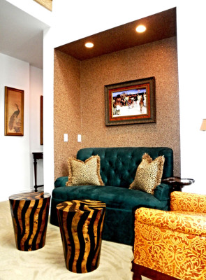 Photo of a family room sitting area alcove with mica wall-covering, tufted ultrasuede love seat, gaufrage leather chair, penn-shell inlaid tables, and  exotic loop and cut carpeting. Interior design by Steven C. Adamko, owner and founder of Spectrum Interiors, established in 1982 in Kalamazoo Michigan