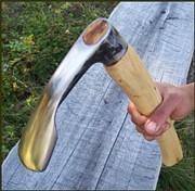 Adze held chocking up the handle