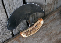 showing the stem and tang of a handmade ulu