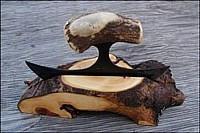 ulu held in a wood block