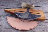 leather working ulu and block.