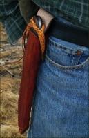 Handmade knife belt sheath with a long braided lanyard.