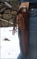 Bush equipped knife sheath worn on a belt
