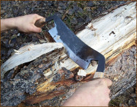 draw knife shaping a log