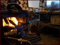 welding on a handmade bushcraft knife by a woodstove on a cold winter day