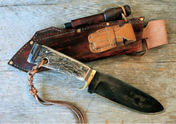 Hand forged survival knife