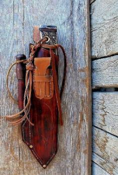 A tough sheath saddle stitched by hand