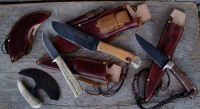 Custom made hunting knife set unsheathed