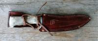 a sheathed Moose knife