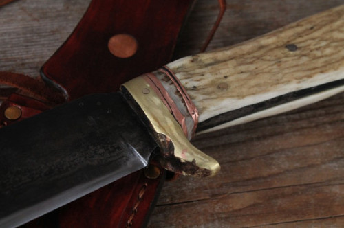 brass and copper work on the Boar knife guard