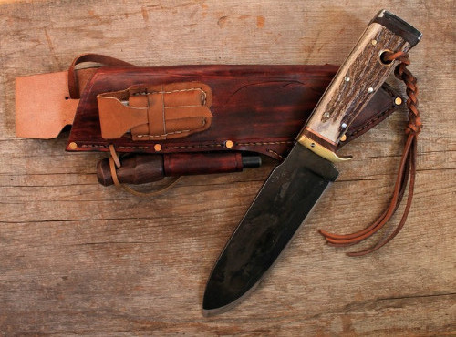 A customMountain Caribou hand forged survival knife