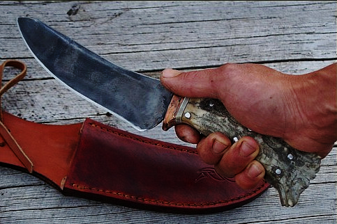 Canadian survival knife, the Moose Knife, in hand.